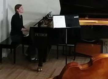 Heather Dale at the piano